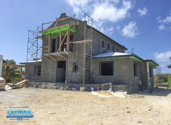 Looking at the front of the luxury custom home near Vista Del Mar, you can see that work has progressed on the roof and outer structure of the home.