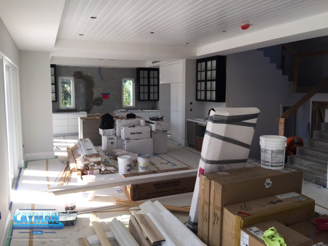 Shelving countertops and appliances are being installed in the kitchen of the luxury custom