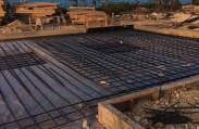 Rebar is installed in the footprint of the luxury custom home before the concrete foundation is poured. This home will feature six bedrooms and six bathrooms.