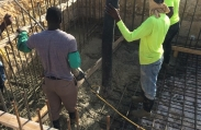 Workers prepare to pour concrete and complete the concrete foundation on this luxury custom home in Vista del Mar, Grand Cayman.