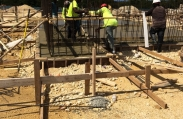 Workers adjust rebar at the custom luxury home construction site in Vista del Mar.