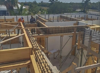 This home is being built using insulating concrete form (ICF) blocks. Here, you can see the rebar supports that will make up the floor beams for the second story.