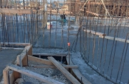 With the concrete foundation complete and rebar supports forming the base of the walls, you can begin to see the massive custom luxury home take shape.