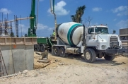 Concrete is pumped from a truck onsite to build the walls and foundation of this massive luxury home.