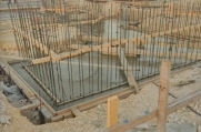 Construction crews secure rebar supports as they continue work on the concrete shell of the custom luxury home.