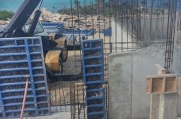 A crane assists in construction at the site in Vista del Mar, West Bay.