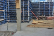 Here, you can see a wooden mold that is being used in the formation of a concrete beam.