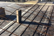 Rebar supports are placed on the second story of this luxury home before more concrete is poured.