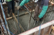 Concrete is pumped to form additional walls and floors for this custom luxury home.
