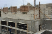 Another view of the garage and guest home that will cater to the property.