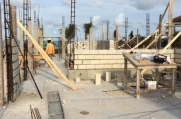 Concrete blocks laid on the walls of the structure with rebar heading upwards.