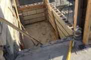Floor of the structure where a hole is being filled.