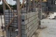 Concrete bricks laid with rebar vertically ran through them.