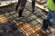 Concrete is poured into the rebar.