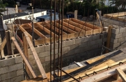 Wooden boards create formwork of the second floor.