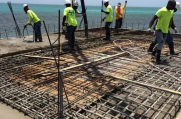 Concrete is poured into the rebar of the second floor.