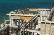 The formwork and framework of the second floor is visible, concrete has yet to be laid.