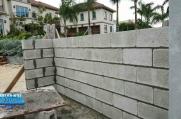 Blocks to entrance gateway walls and garbage enclosure.