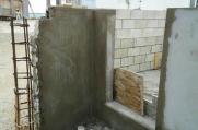 Plastering has begun to the garbage enclosure walls.