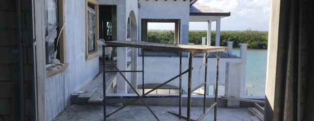 Scaffolding on the second floor of the luxury home.