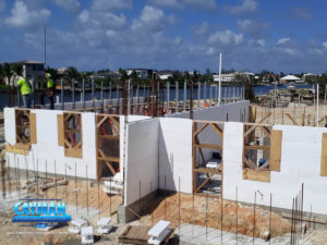 Crew members work on the second level of ICF wall reinforcement.