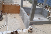 The elevator shaft, and the plumbing to the pool.