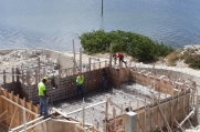 A view of the pool with the rebar grid and plastic down.