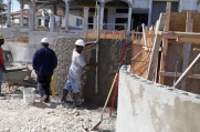 A crew member smooths the curved wall in the inner courtyard.