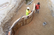 Workers begin on the koi pond wall.