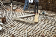 Crew members finish up the rebar to pour the concrete for the pool.