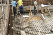The wooden frames mold the concrete as it dries.