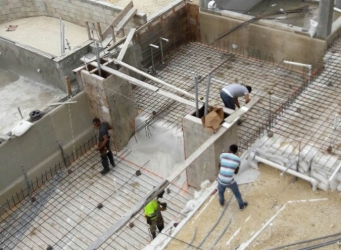 Workers lay the rebar for the main pool.