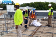 The MEP team checks the wiring and plumbing on the second floor.