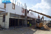 The top level of ICF gets built with the help of a crane operator.