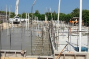 Pouring concrete foundations in this Cayman Islands development.