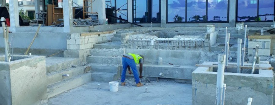Smoothing out the concrete on the main stairway.