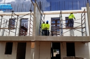 Placing scaffolding in a completed ICF room of the house.