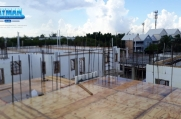 Rain on the roof of some of the recent construction at Periwinkle.